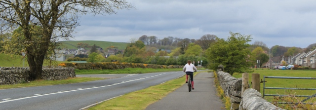 24 cyclist on the cycle route, Ruth hiking through Dumfries and Galloway