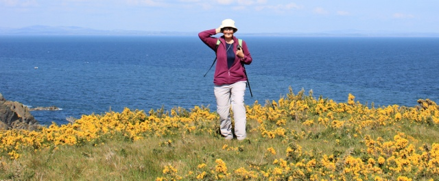 32 self portrait, Ruth walking the coast of Scotland, Withorn