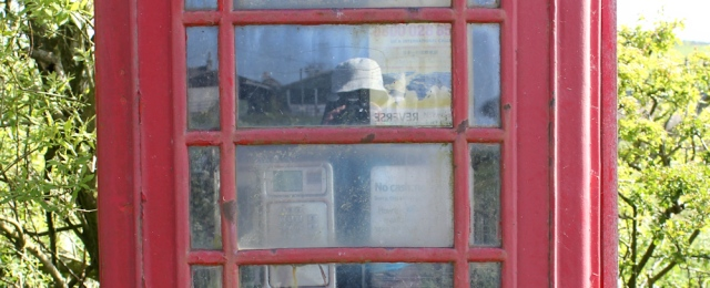 08 self=portrait in a phone box, Ruth Livingstone