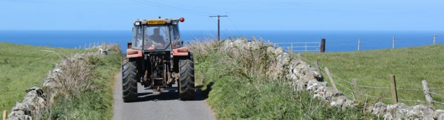 12 red tractor on road, Ruth's coastal walk, The Rhins, Scotland