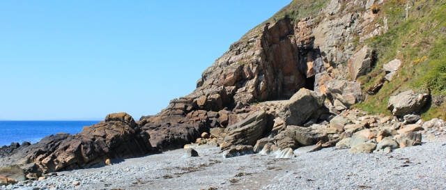 12 St Ninian's cave and crosses, Ruth hiking the coastal path, Galloway, Scotland