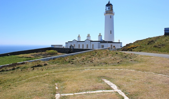 26 a lighthouse, Ruth walking the Mull of Galloway Trail, Scotland