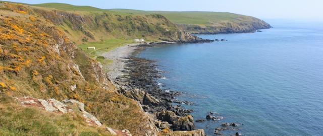 38 picnic stop above Morroch Bay, Ruth hiking to Portpatrick, Galloway, Scotland