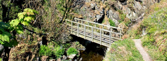 40 bridge to Dunskey Castle, Ruth hiking to Portpatrick, Galloway, Scotland