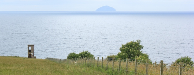 19 watchtower and Ailse Craig, Ruth hiking the coast, Scotland