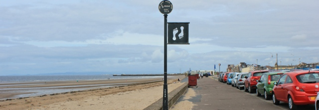 20 footprint markers, Ayr promenade, Ruth hiking the coast of Scotland