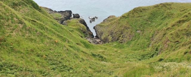 27 cove below Downan Point, Ruth hiking the Ayrshire Coastal Path, Scotland
