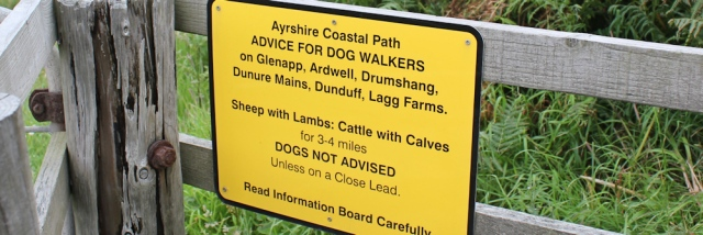 28 warning sign, Ruth walking the Ayrshire Coastal Path, Scotland