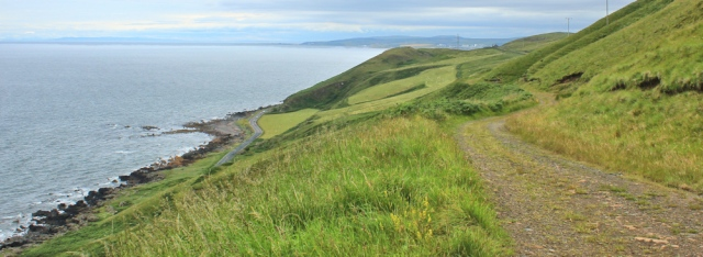 31 Walking towards Ardwell Bay, Ruth hiking the Ayrshire Coastal Path