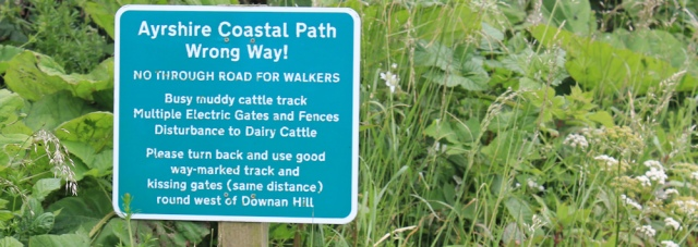 32 Ruth hiking the Ayrshire Coastal Path, Scotland, wrong way sign