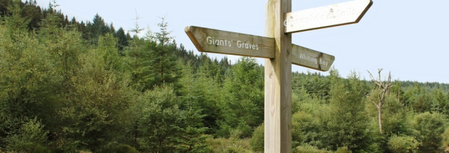 09 signpost to Giants Graves, Ruth hiking in Arran