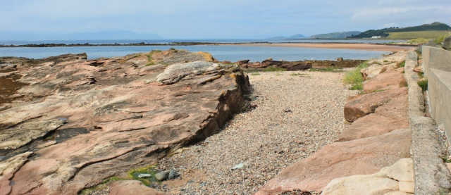 14 red sandstone rocks, Ruth walking from West Kilbride to Portencross, Scotland