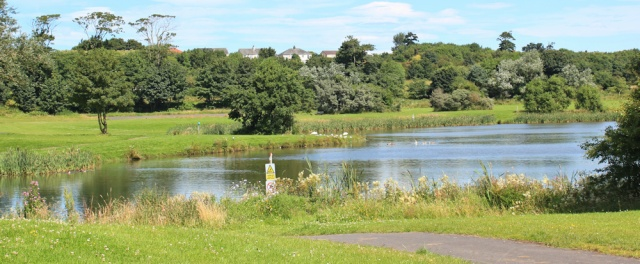 20 lake in Ardeer Park, Ruth hiking the Ayrshire Coast Path, Scotland
