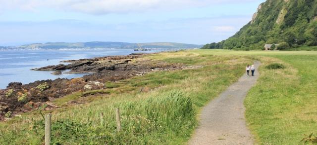 21 Ruth hiking the Ayrshire Coastal Path, Scotland, towards Fairlie