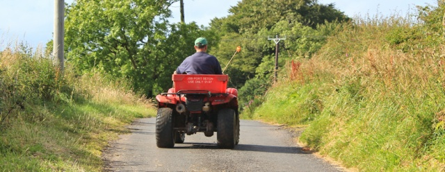 27 farmer on a quad bike, Ruth Livingstone walking the Scottish Coast