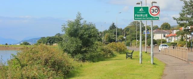 39 Fairlie fairtrade village sign, Ruth hiking the Ayrshire Coastal Path, Scotland