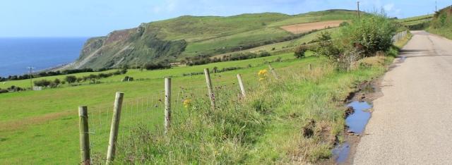 04 road to Lagg, Ruth hiking the Arran Coastal Way