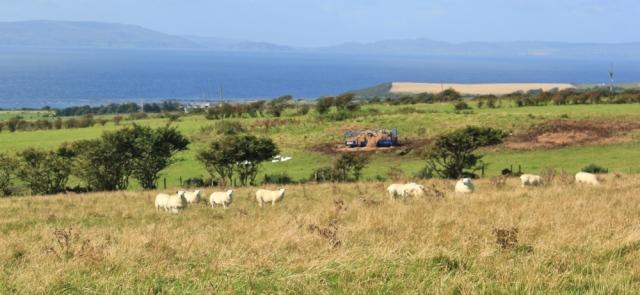09 view of the Ayrshire coast, Ruth hiking around Arran