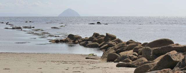 22 Ailsa Craig, from Kilmory beach, Ruth hiking around Arran