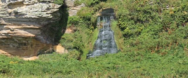 23 waterfall, Ruth hiking along the Arran Coastal path