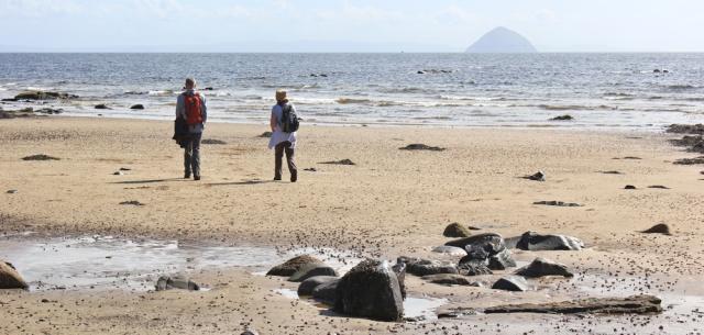 25 hikers on the beach, Arran Coastal Way, Ruth hiking in Scotland