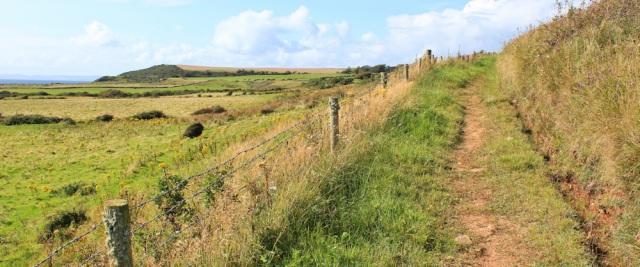 29 path up to Kilmory, Ruth hiking the Arran Coastal Way