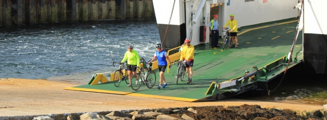 31 cyclists getting off ferry at Lochranza, Arran