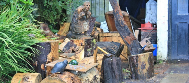 10 wood sculptor and carver, Ruth walking through Corrie, Isle of Arran
