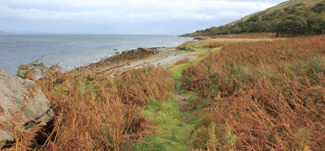 27 north coast of Arran, Ruth hiking the coast of Scotland