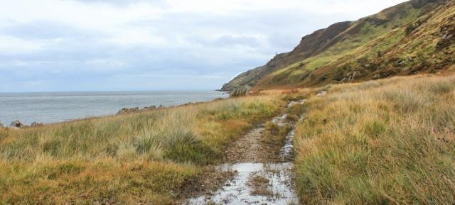 33 track, Ruth hiking the north coast of Arran