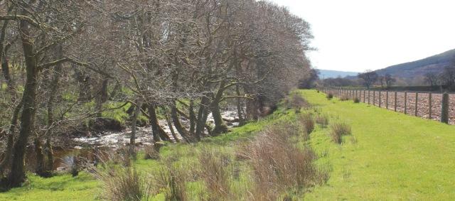 20 banks of Abhainn Breacairigh, Ruth hiking the Kintyre Way