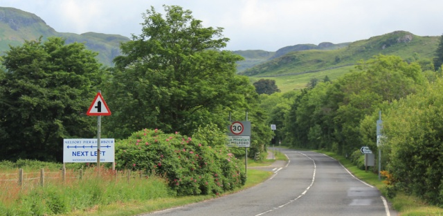 14 turnoff to Melfort, Ruth hiking the coast of Scotland