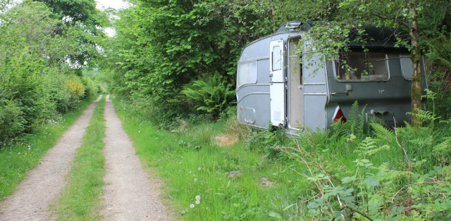 58 caravans in the trees, Ruth hiking in Scotland