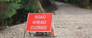 road closed, Ruth hiking in Scotland