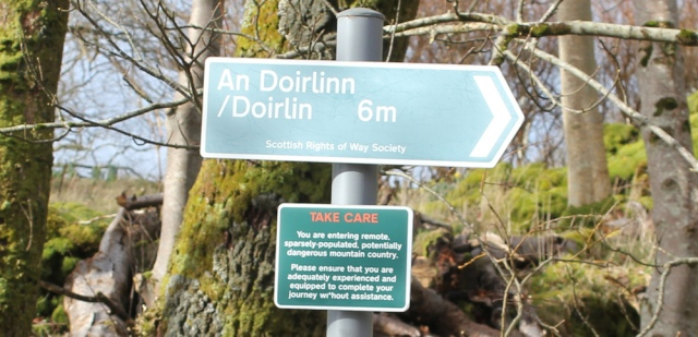 30 sign to Doirlinn, Ruth hiking the coast of Morvern Peninsula