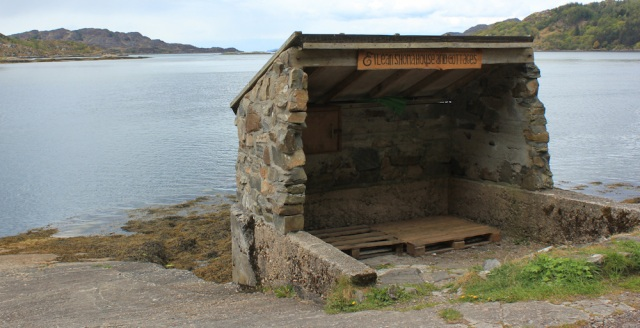 30 Eilean Shona shelter for ferry, Ruth walking towards CastleTioram. Doirlinn, Scotland
