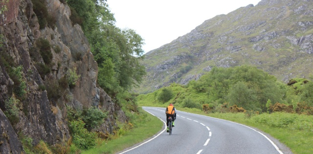 36 lone cyclist, Ruth walking up Loch Ailort, Scotland