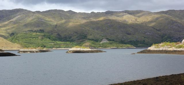37 Eilean Dubh, Ruth walking up Loch Ailort, Scotland