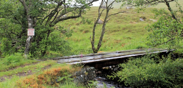01 bridge with cow warning, Ruth walking to Corran, Scotland