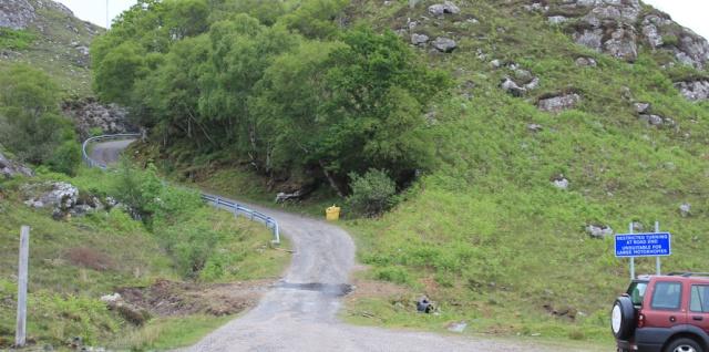 05 vehicle warning sign, Ruth walking around Loch Morar