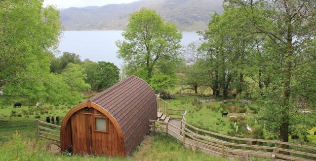 08 holiday huts, Ruth walking along the shore of Loch Morar
