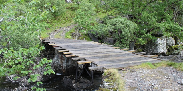 10 repaired bridge, Ruth walking down Glen Arnisdale to Corran