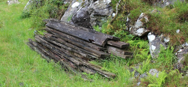 11 pile of planks near bridge, Ruth walking down Glen Arnisdale to Corran, Scotland