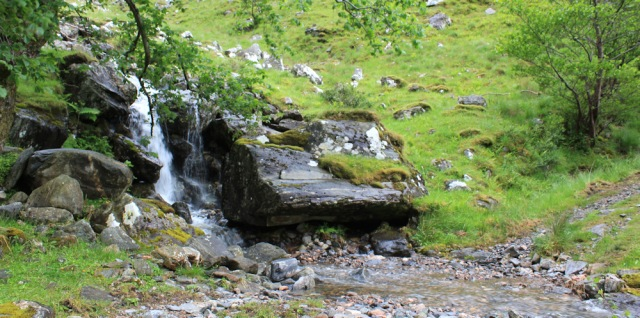 12 waterfalls across the track, Ruth walking down Glen Arnisdale to Corran