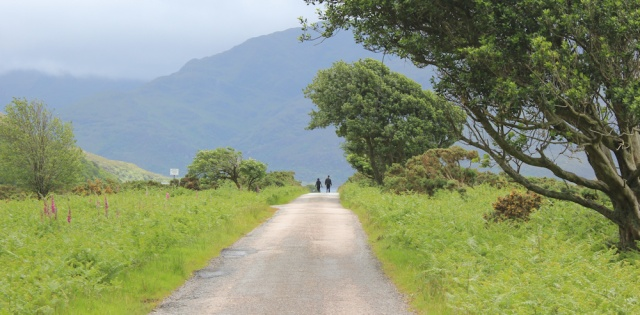 16 walkers on road back to Corran, Ruth hiking the coast of Scotland