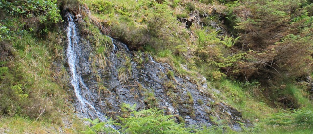 17 waterfalls down rocks, Ruth walking the Scottish coast from Arnisdale to Sandaig