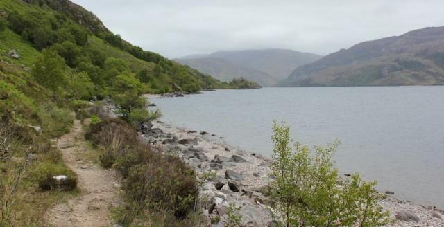 18 path along shore, Ruth hiking up Loch Morar