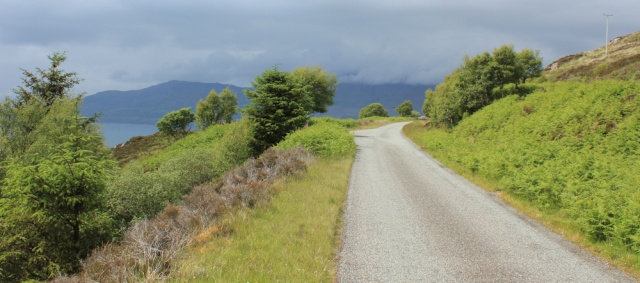 19 first view of Skye, Ruth walking the Scottish coast from Arnisdale to Sandaig