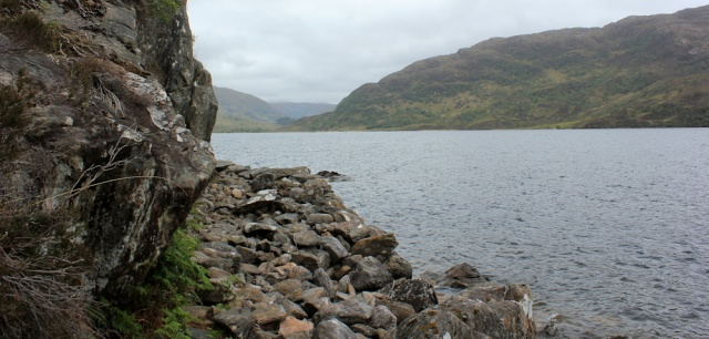 21 rocky path beside water, Ruth hiking the shore of Loch Morar