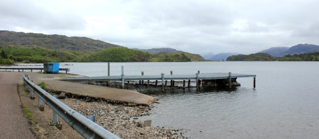 35 jetty on Loch Morar, Ruth hiking around the coast of Scotland